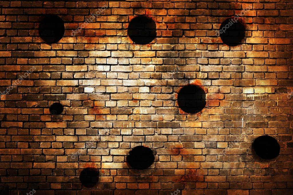Old Brick Wall With Bullet Holes Stock Photo