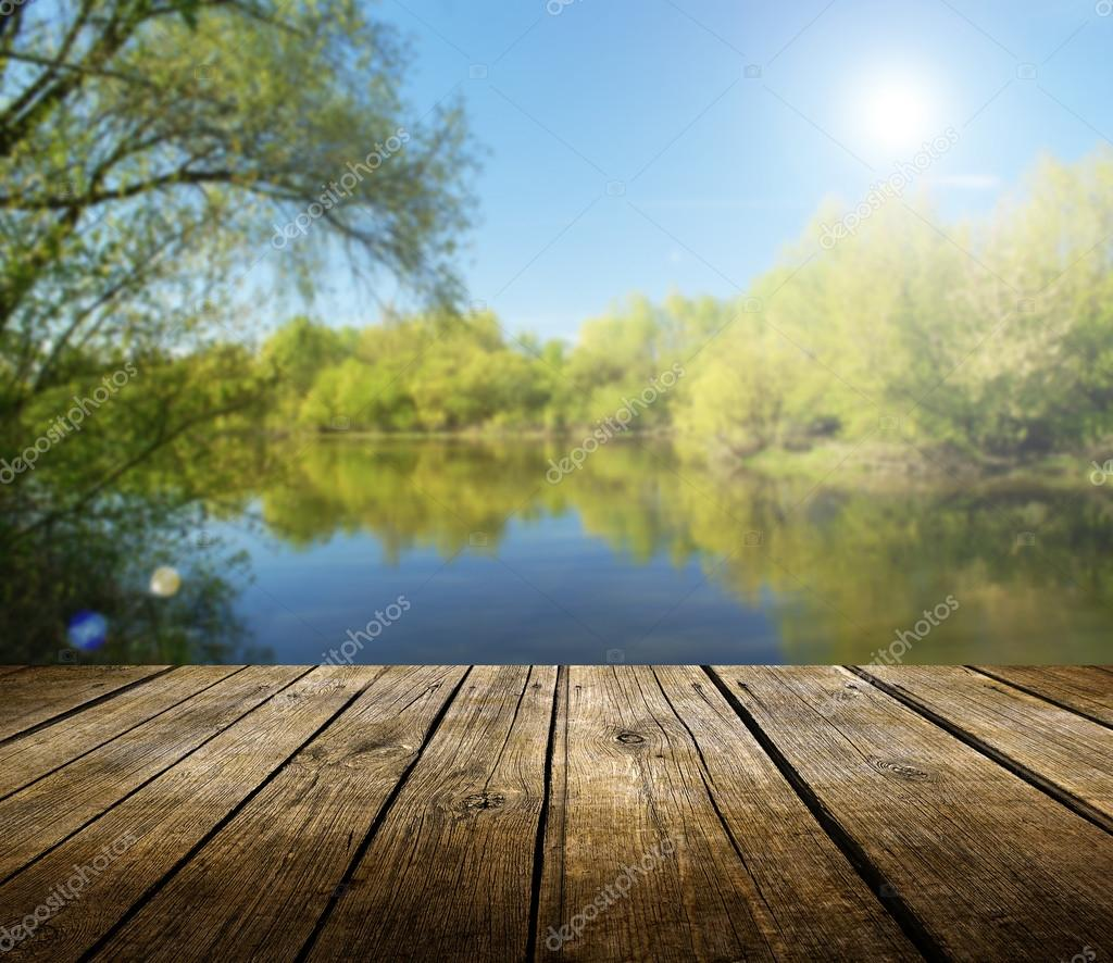 Spring lake background with empty table