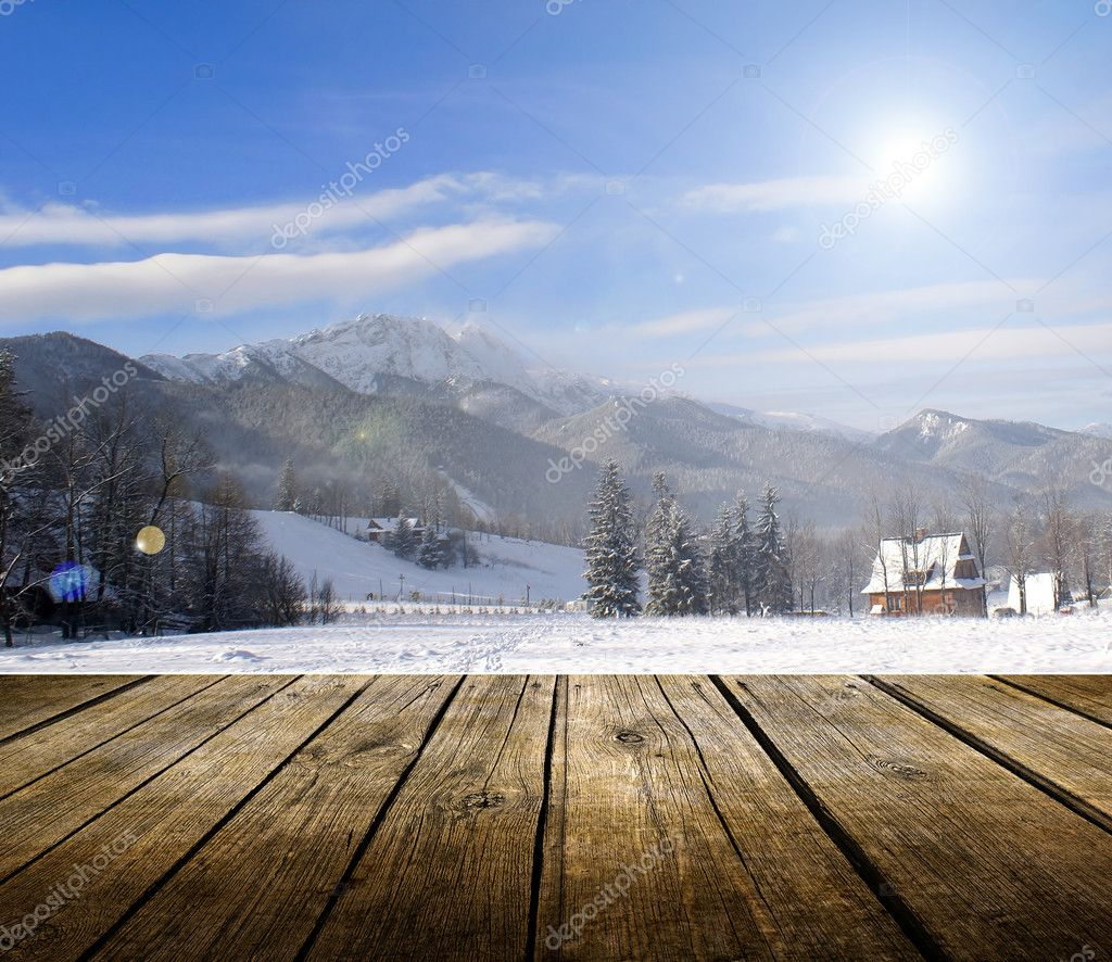 Empty wooden deck table with winter background