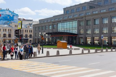 People facing a crosswalk
