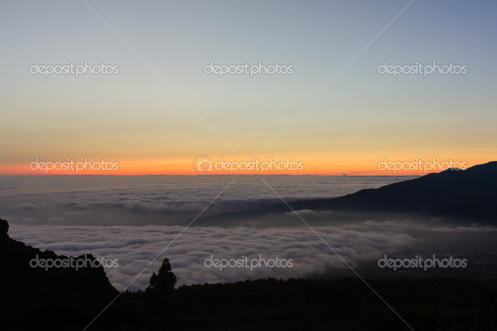 Colorful sunset at La Palma with a view over the low-hanging clo