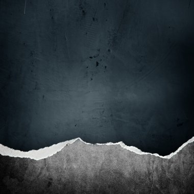 riped vintage paper on grunge background