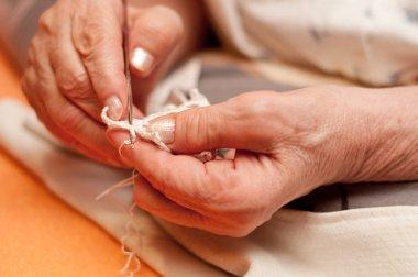 Women's hands crocheting