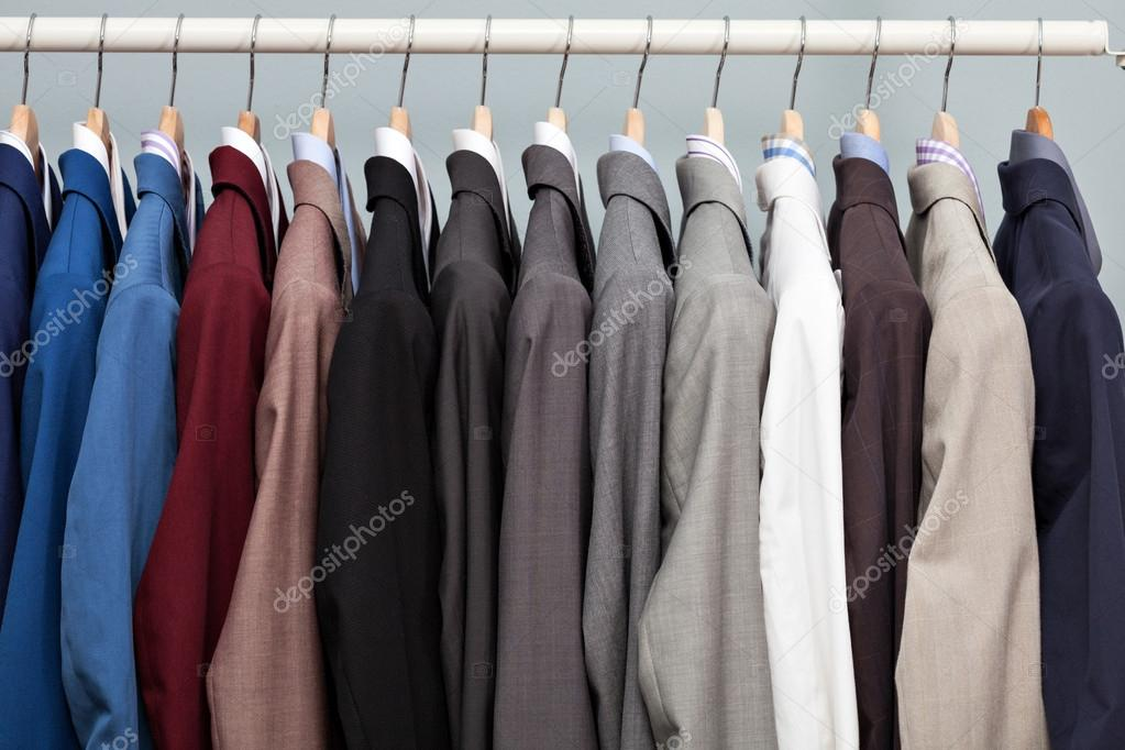 Display of man suits in a closet