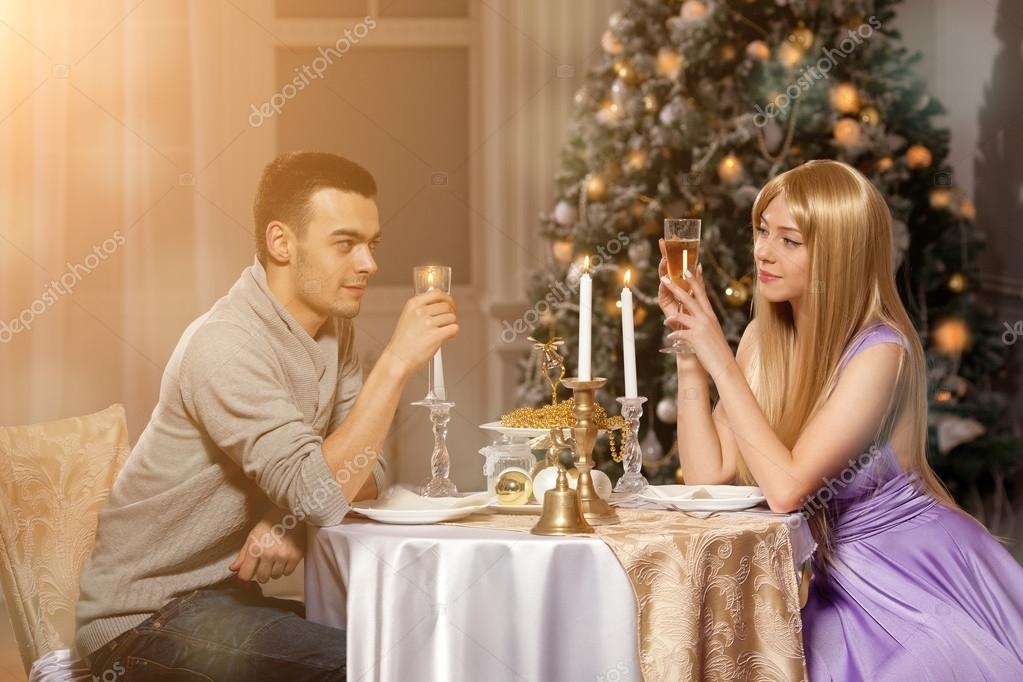 Two lovers on a romantic dinner by candlelight. Man and woman to