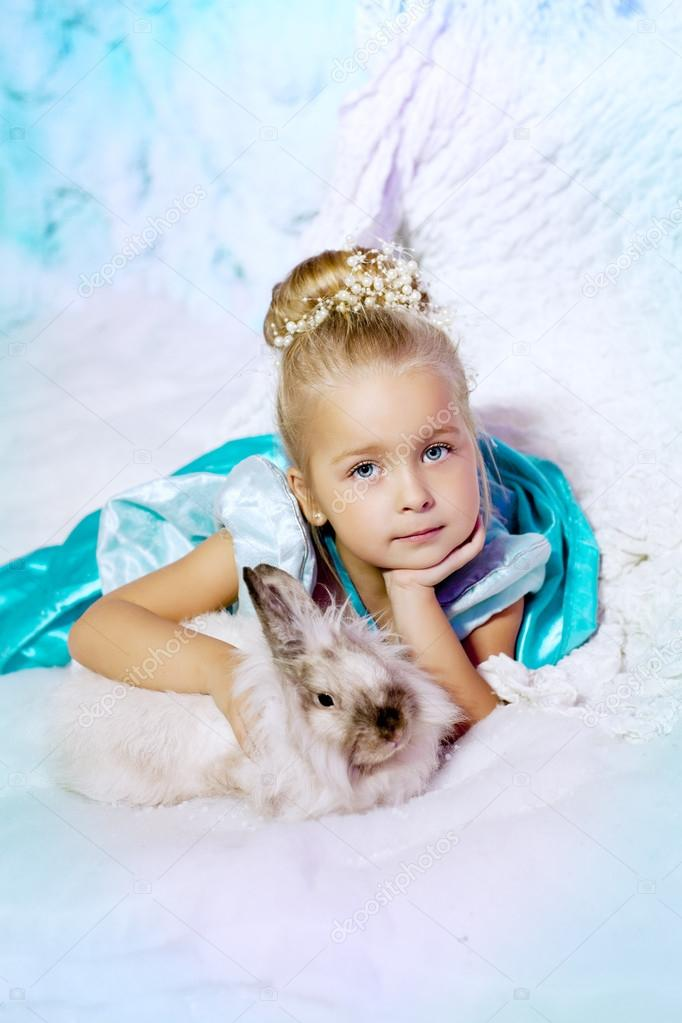 5321cd7a4c14f Little girl in princess dress on a background of a winter fairy tale. Baby  snow queen. Sweet smiling child snowy kingdom. Kid in in carnival costume.