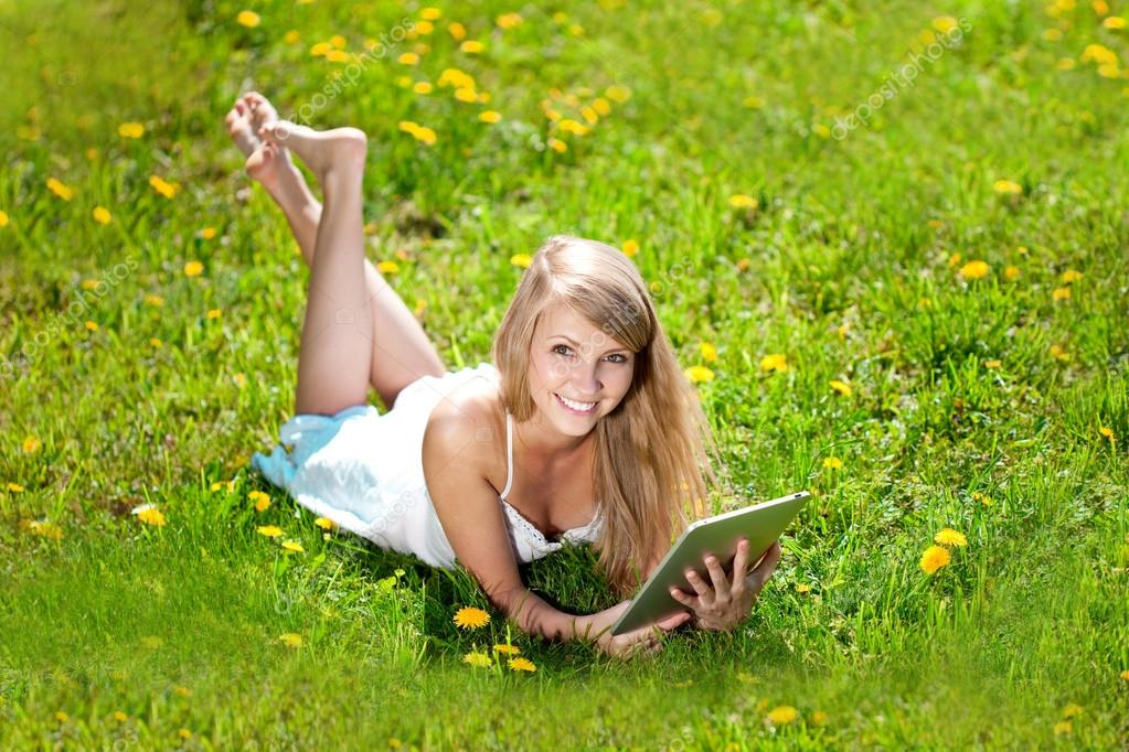 Beautiful smiling woman with tablet pc, outdoors. Beautiful youn