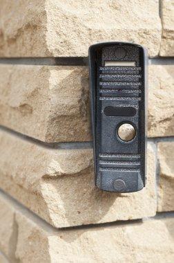 Door bell on brick wall