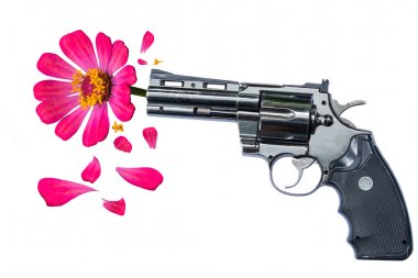 Pink flower hanging from the gun barrel