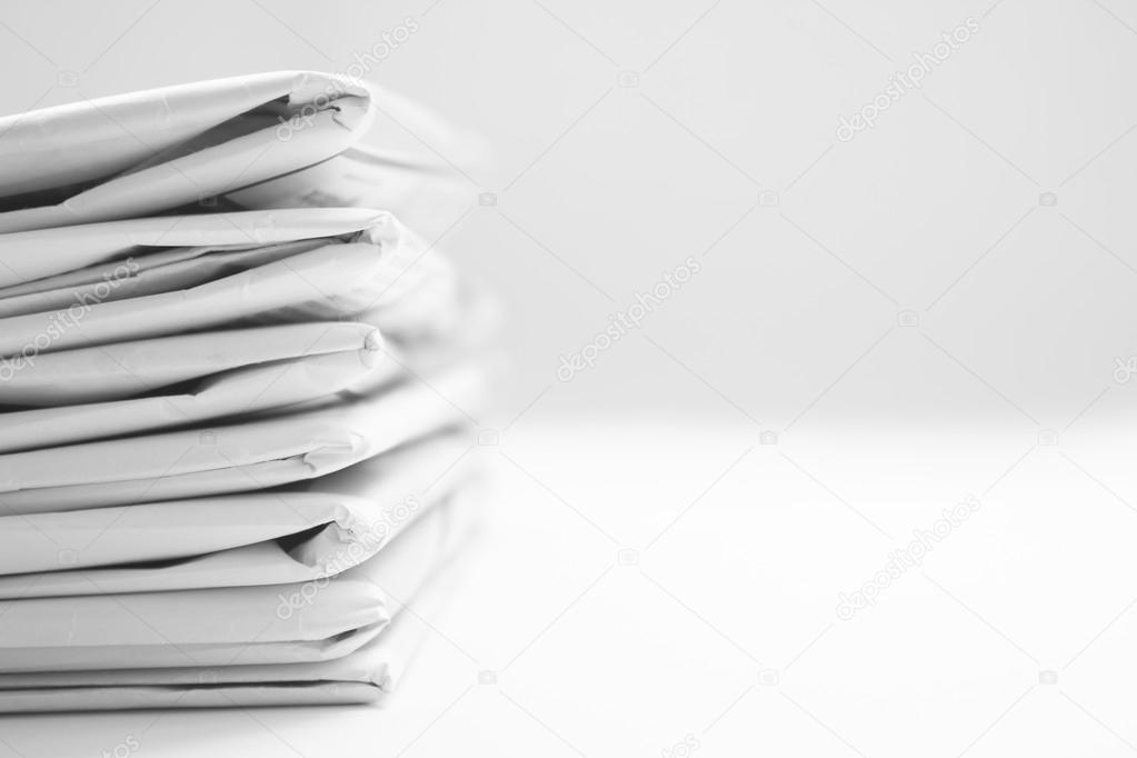 Stack Of Black And White Newspaper Background Stock Photo
