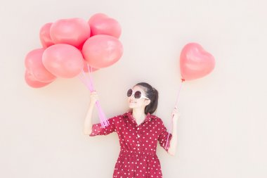 Girl With Colorful Heart Balloons