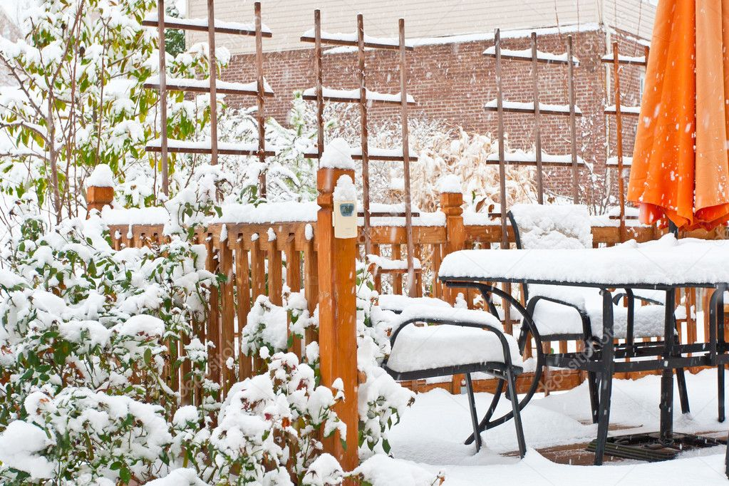 Snow on garden patio, winter scenery