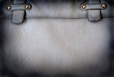 A black leather bag background