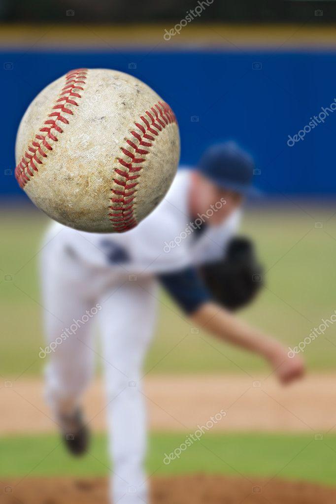 Baseball pitcher throwing ball