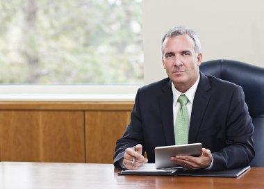 Mature Businessman using tablet computer