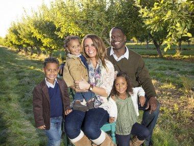Beautiful Multi Ethnic Family Portrait Outdoors