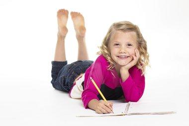 Cute little girl doing her homework