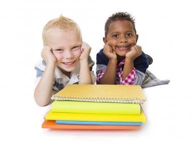 Two diverse little school children with their books