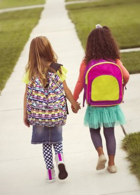 Little girls walking to school together