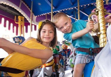 Kids having fun on a carnival carousel