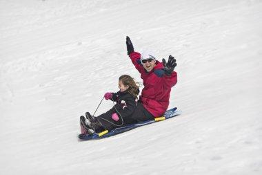 Snow sledding fun stock vector