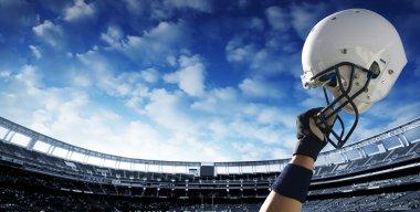 Football player raises his helmet