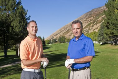 Two male golfers playing golf together