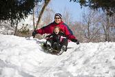 Fotografie Familie Spaß zusammen Schneeschlitten