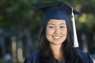 Asian woman in graduation cap