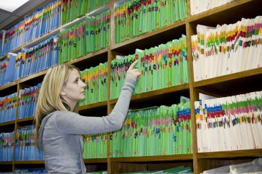 Woman working with medical records