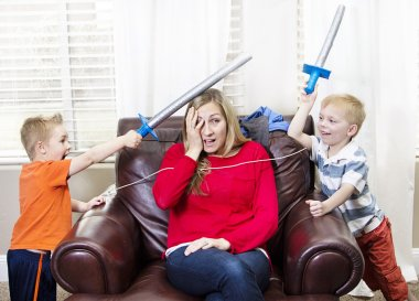 Young Mother overwhelmed by her kids