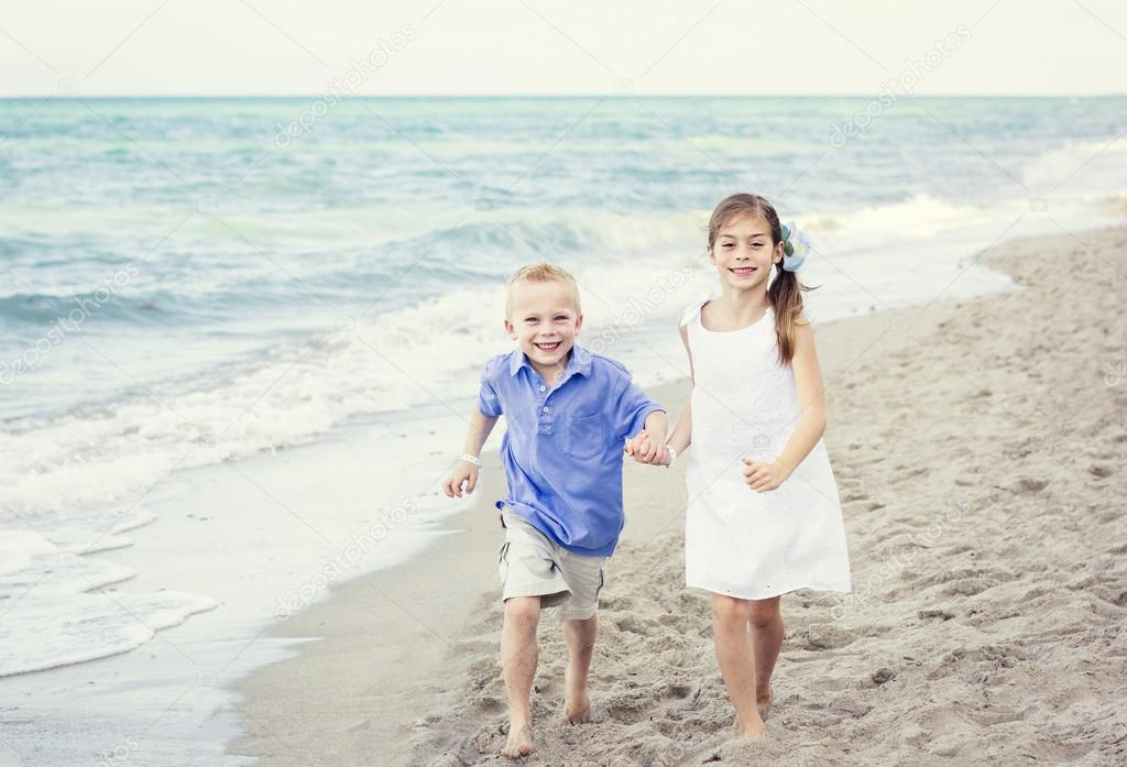 Smiling Children running at the beach