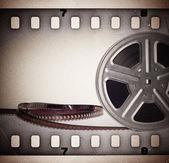 Régi mozgókép film orsó Filmszalag. Vintage háttér