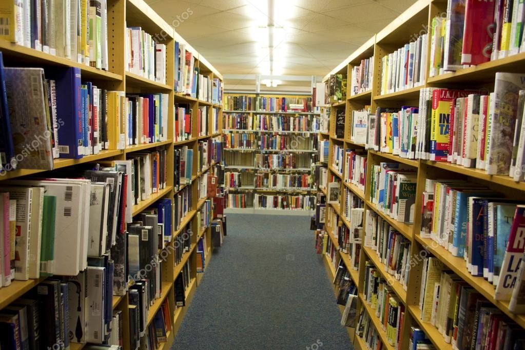 Bookshelves Full Of Books Inside Of A Library Stock Photo