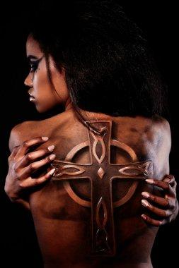 Beautiful black American woman with tattoo on back
