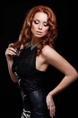 Sexy redhead stylish woman in black dress