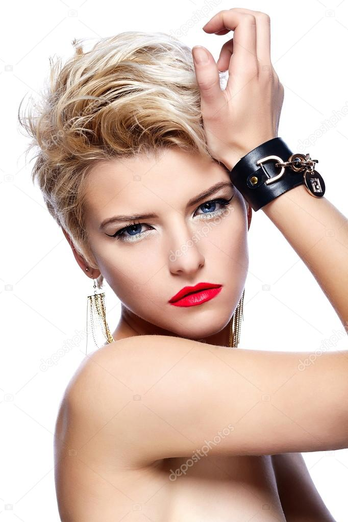 High fashion look.glamor closeup portrait of beautiful sexy blond Caucasian young woman model with red lips,bright makeup, with short hair with perfect clean skin