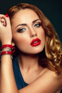 High fashion look.glamor closeup portrait of beautiful sexy stylish brunette Caucasian young woman model with bright makeup, with red lips, with perfect clean skin with accessories in studio