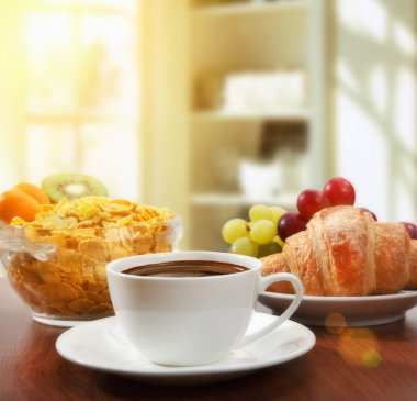 healthy breakfast with coffee in sunny morning