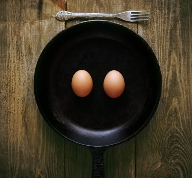 smiling eggs in pan
