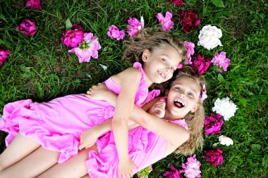 portrait of two twins with peonies