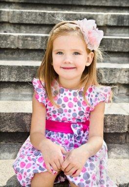 Outdoor portrait of cute little girl