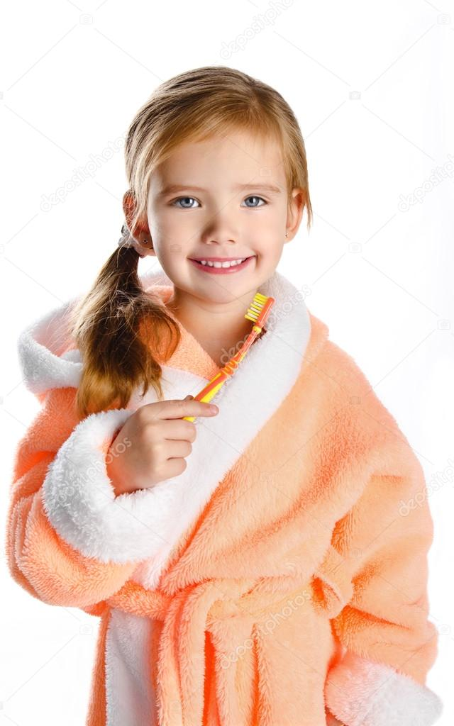 Little girl in dressing gown brushing her teeth isolated — Stock ...