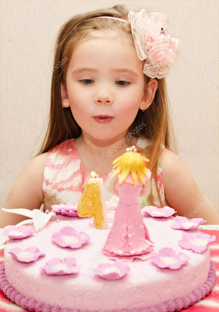 Portrait Of Little Girl And Her Birthday Cake Stock Photo