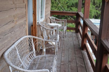 Cottage interior balcony. Country-style.