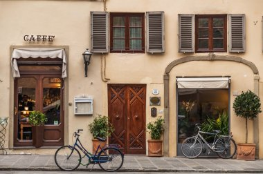 Bicycle next to caffe shope, Tuscany, Italy