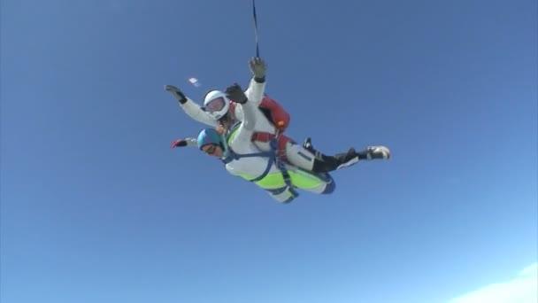 Skydivers in tandem