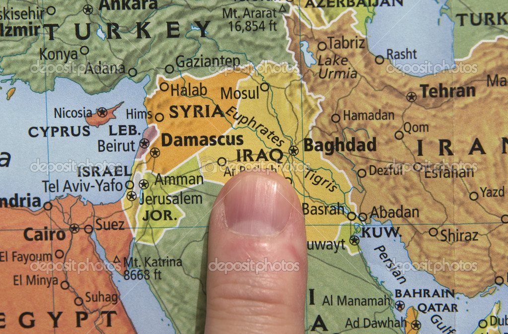 map of iraq with finger pointing out the location photo by jjvallee