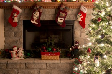 Christmas Tree And Fireplace With Christmas Stockings
