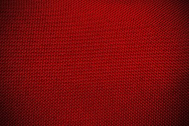 red canvas texture background with dark maroon vignette